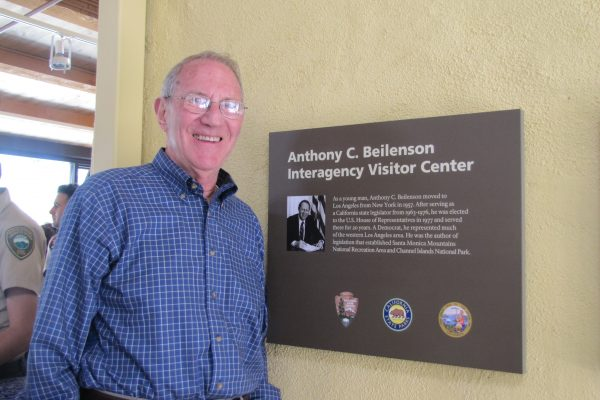 Mr. Beilenson with plaque inside Visitor's Center