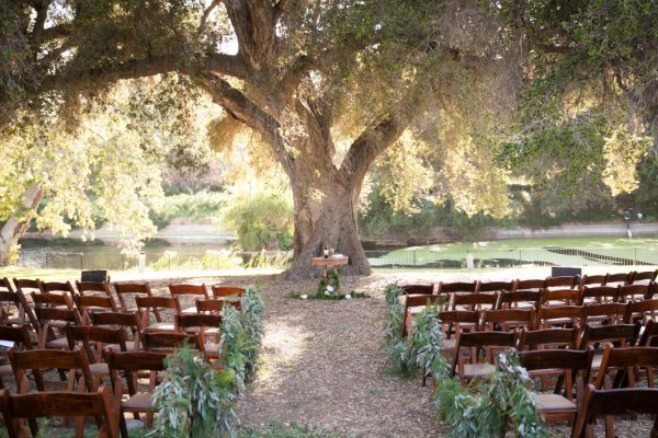 Wedding Ceremony under the Oak tree by the pond. Photo courtesy of Amber Events