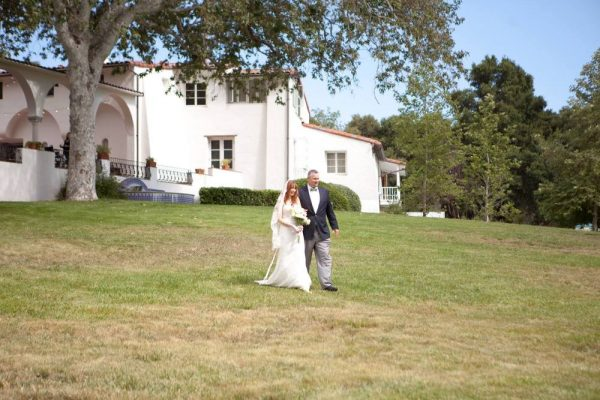 Walking down from the mansion to the ceremony, Photo courtesy of Burlap & Rose Events
