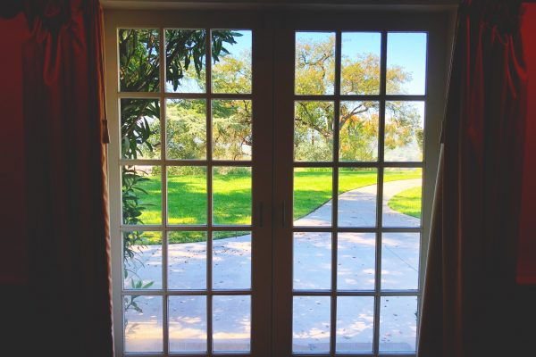 French doors open out to the picturesque back gardens.