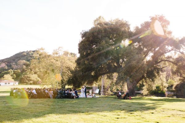 Ceremony on the mansion lawns. Photo by Annie McElwain Photography
